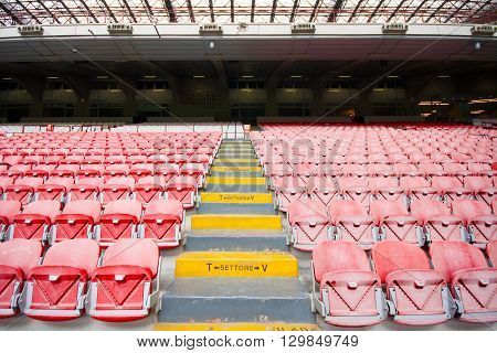 Empty stadium and plastic chairs on a tribune