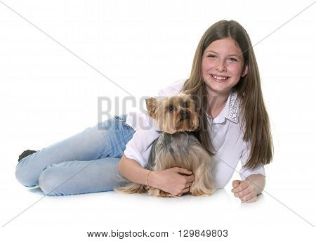 yorkshire terrier and teenager in front of white background