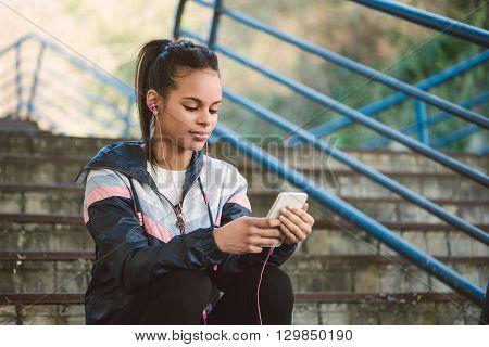 Beautiful Hispanic Woman Listen Music After Running