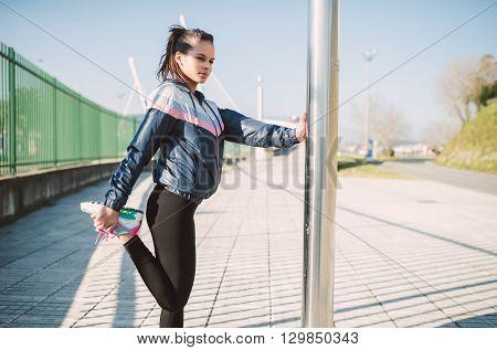 Beautiful Hispanic Woman Doing Stretching Before Running