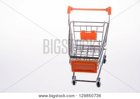 A shopping cart on a  white background