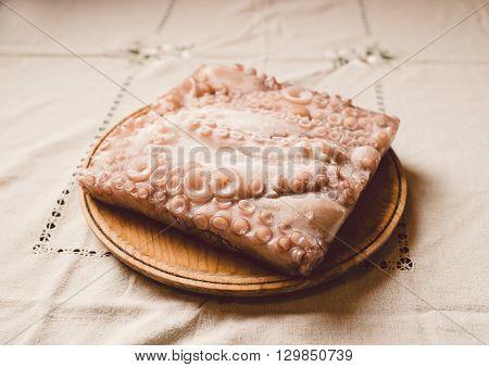 Frozen Octopus In A Wooden Plate
