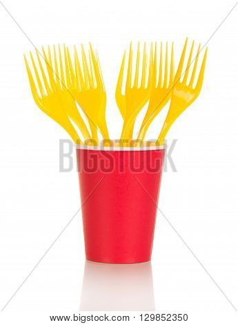 Bright disposable cups and plastic forks isolated on white background.