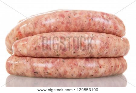 Raw pork sausages isolated on white background.