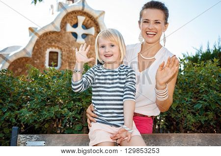 Happy Mother And Child Handwaving In Park Guell, Barcelona