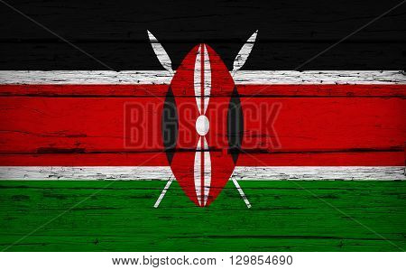 Kenya grunge wood background with Kenyan flag painted on aged wooden wall.