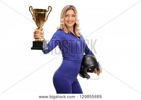 Female car racing champion holding a gold trophy and showing it towards the camera isolated on white background