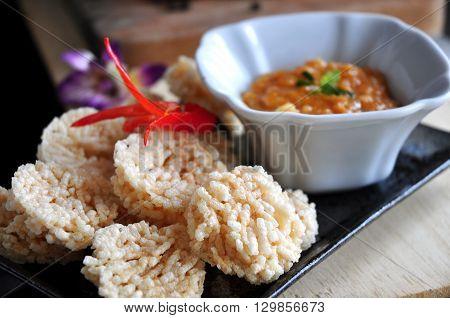 Close up rice cracker dish with dip sauce