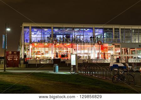 MONTREAL CANADA - 17TH MAY 2015: The outside of Bars and Restaurants near the Old Port of Montreal at night. People can be seen.