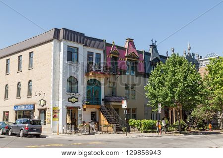 MONTREAL CANADA - 17TH MAY 2015: Streets in Montreal. The outside of buildings and people can be seen.