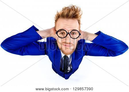 Funny smart guy in a suit and spectacles smiles into the camera. Isolated over white.