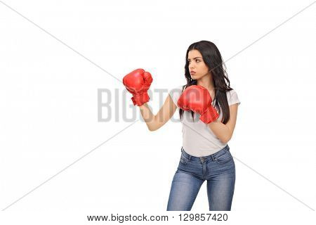Studio shot of a young woman with red boxing gloves isolated on white background