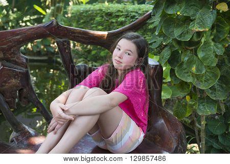 10-11 year old girl in the garden.