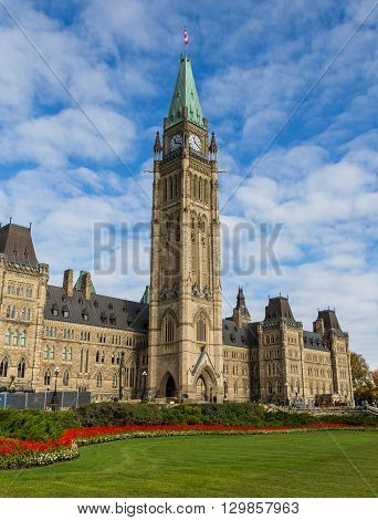 OTTAWA CANADA - 12TH OCTOBER 2014: The houses of parliament in Ottawa from the distance. People can be seen outside