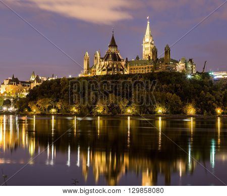 Parliament Hill in Ottawa at night from across the Ottawa River