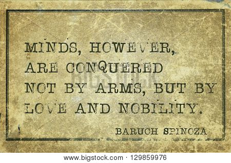 Minds however are conquered not by arms - ancient Dutch philosopher Baruch Spinoza quote printed on grunge vintage cardboard