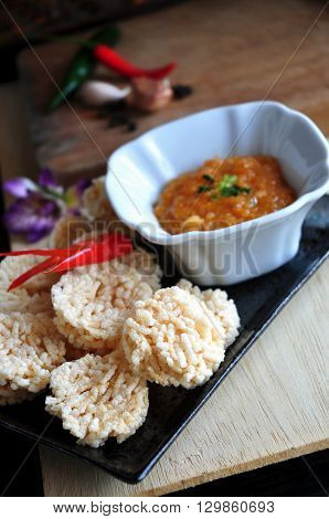 Dish of rice cracker with spicy dip sauce