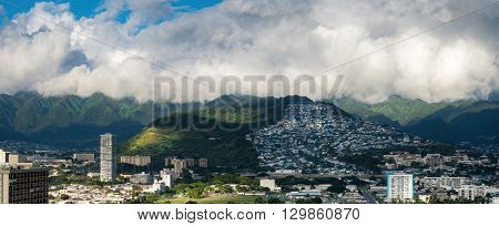 Waikiki, Honolulu, Hawaii, USA - Dec 15, 2015: Panoramic morning view of the Palolo region that backs against the distant hills. Dramatic cloud patterns. On the 30th floor of the Hyatt Regency Hotel.