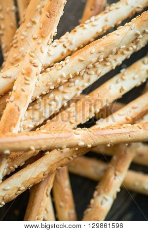 Bunch Of Homemade Grissini Breadsticks On Wooden Surface