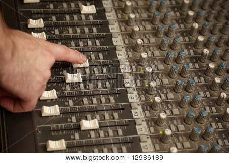sound producer moving one fad of dusty sound mixer