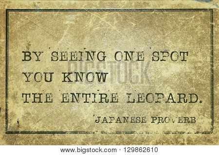By seeing one spot you know - ancient Japanese proverb printed on grunge vintage cardboard