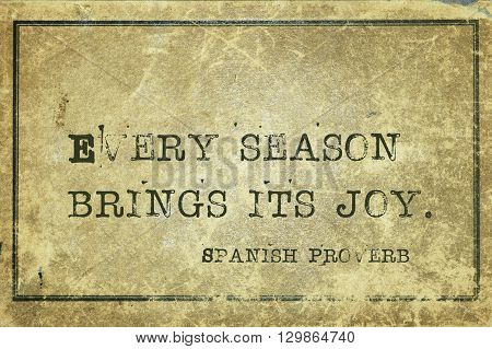 Every season brings its joy - ancient Spanish proverb printed on grunge vintage cardboard