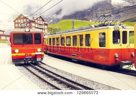Kleine Scheidegg, Switzerland - July 09, 2012: Train to Kleine Scheidegg arrives from Jungfraujoch station.