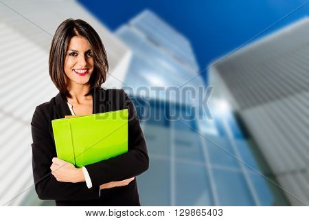 young business woman over business headquarter background