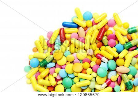 Lot of different medicine pills on a white background
