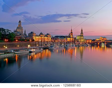 View of the historical waterfront of the Old Town of the city of Dresden Saxony Germany at sunset with the Blue Hour setting in.