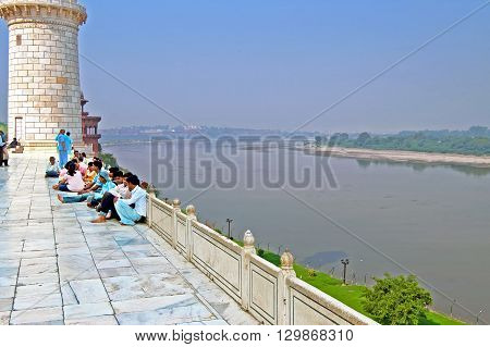 AGRA, INDIA - OCTOBER 18, 2008: People near Taj Mahal and view on Yamuna River from Taj Mahal in Agra. India. The Yamuna, sometimes called Jamuna, is the longest and the second largest tributary river of the Ganges (Ganga) in northern India