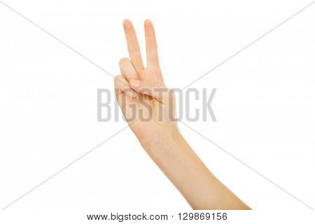 Woman hand shows two fingers