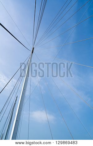 Bridge architecture pylon and steel cables structure clear blue sky background