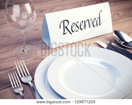 Reserved sign on a restaurant table - 3d render