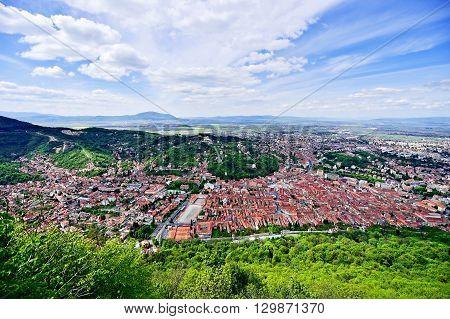 Aerial photo with Transylvania's Brasov medieval old town in springtime