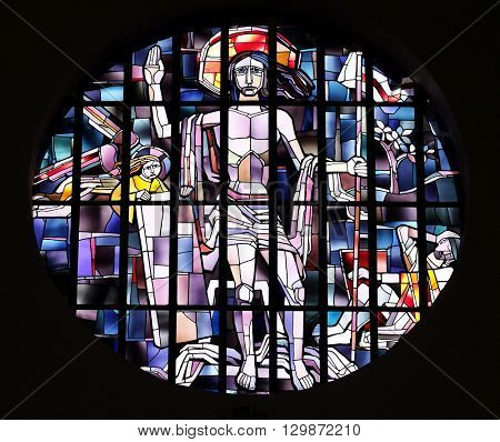 KLEINOSTHEIM, GERMANY - JUNE 08: Saint Lawrence of Rome stained glass window in the Saint Lawrence church in Kleinostheim, Germany on June 08, 2015.