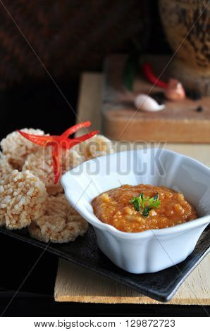 Rice cracker with spicy dipping sauce in Thai style