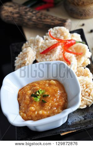 Rice cracker with spicy dip sauce in Thai style