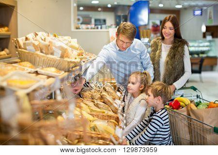 Smiling family in bakery