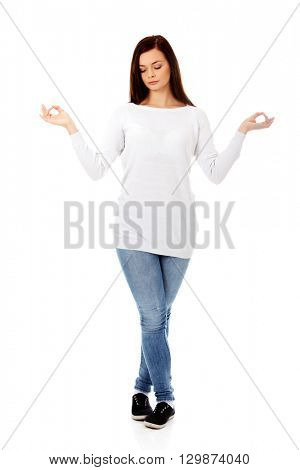 Young woman makes meditating gesture