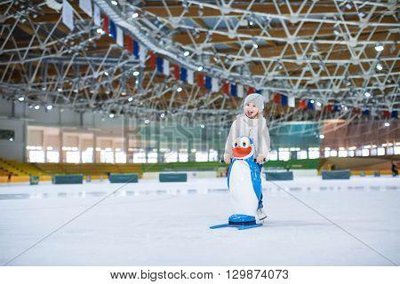 Happy child at skating rink