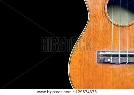 abstract portrait of a ukulele on black background