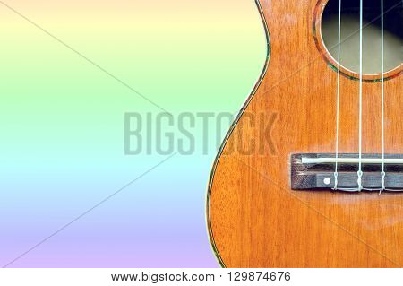 abstract portrait of a ukulele on pastel background