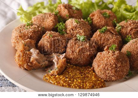 Dutch Meat Balls With Mustard Bitterballen Close-up On A Plate. Horizontal