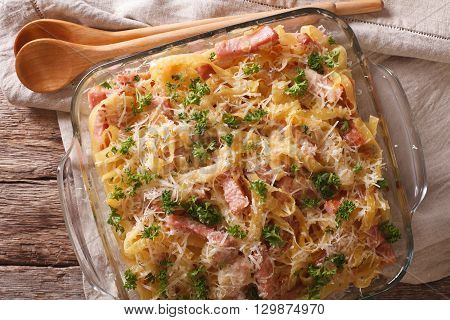 Casserole Noodles With Ham And Parmesan Close-up In A Baking Dish. Horizontal Top View