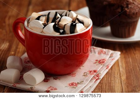Hot chocolate with marshmallow on a rustic table