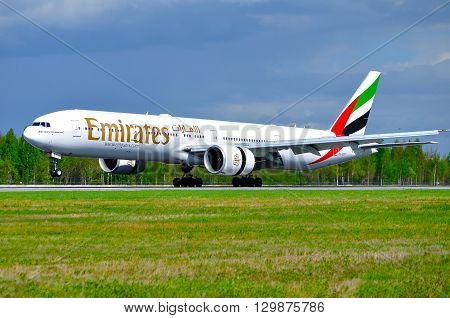 SAINT PETERSBURG RUSSIA - MAY 11 2016. Emirates Airline Boeing 777 airplane-registration number A6-EBY. Airplane is riding on the runway after landing in Pulkovo International airport