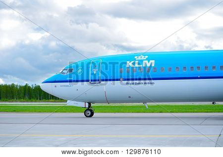 SAINT PETERSBURG RUSSIA-MAY 11 2016. KLM Royal Dutch Airlines Boeing 737 Next Gen airplane-registration number PH-BXT. Airplane is riding on the runway after landing in Pulkovo International airport