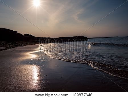 Early morning sunshine on a beach in canada