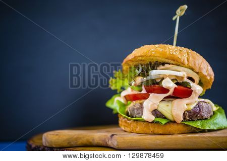 Hamburger, homemade hamburger with beef and fresh vegetables, space for text